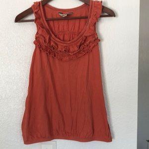Orange ruffled racer-back blouse